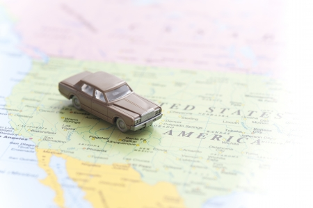 miniature toy car on world map background photo