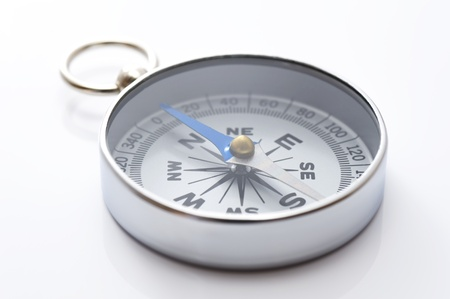 a silver compass on gray background, close-up Stock Photo - 16374889