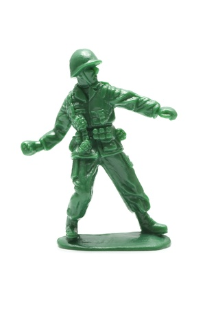 miniture toy soldier on white background, close-up