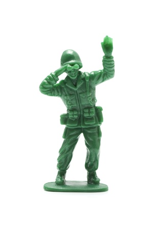 green military miniature: miniture toy soldier on white background, close-up