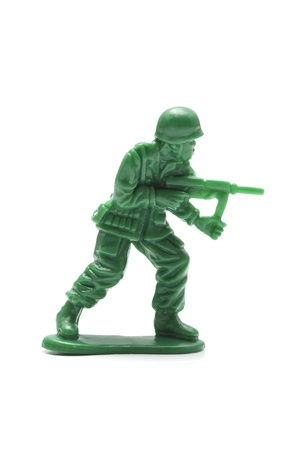 miniture toy soldier on white background, close-up  photo