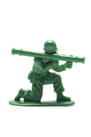 bazooka: miniture toy soldier on white background, close-up