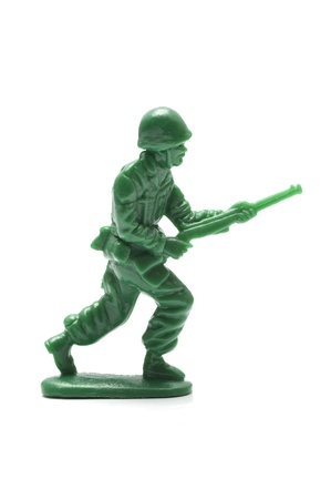 plastic soldier: miniture toy soldier on white background, close-up