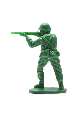 green plastic soldiers: miniture toy soldier on white background, close-up