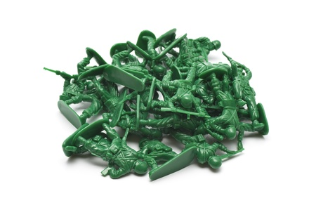 green military miniature: pile of many toy soldiers on white background Stock Photo