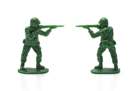 green military miniature: miniture toy soldiers with guns on white background