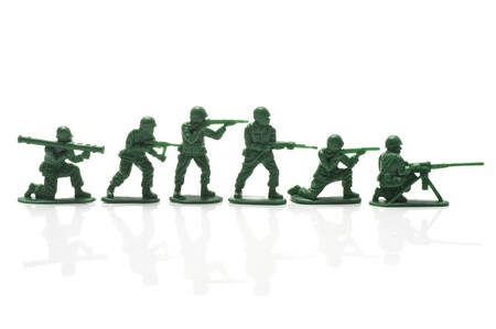 miniture toy soldiers with guns on white background