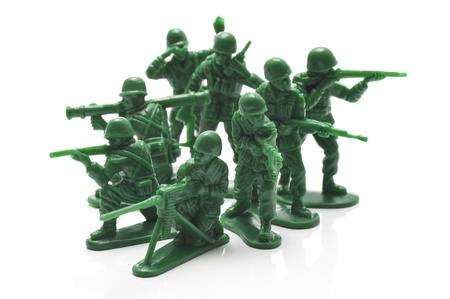 miniture toy soldiers on white background, close-up