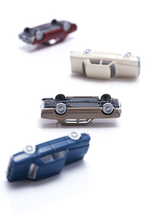 overturn: toy cars isolated on white background, close-up  Stock Photo