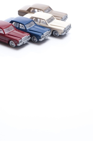 overturn: miniature toy cars isolated on white background