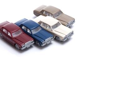 overturn: macchinine in miniatura isolato su sfondo bianco Archivio Fotografico