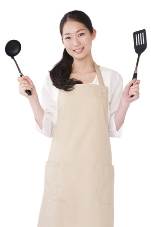 Woman with a ladle and spatula photo