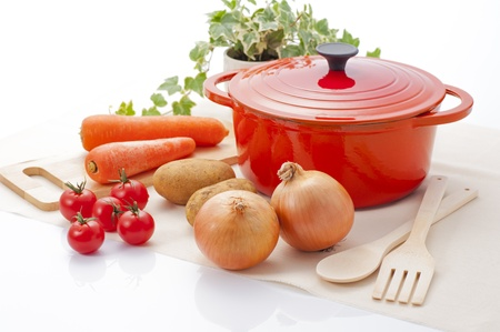 enameled: Red enameled pot and vegetables Stock Photo