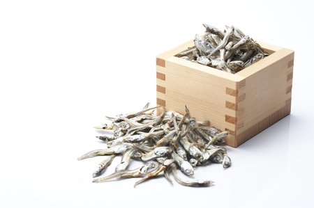 Dried sardine in the wooden square cup