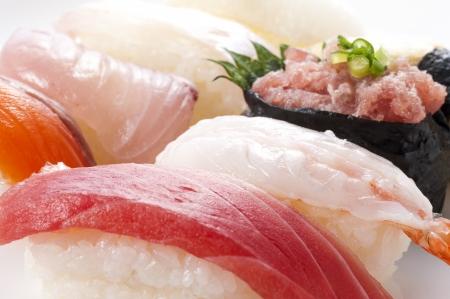 Assorted sushi on white background, close-up Stock Photo