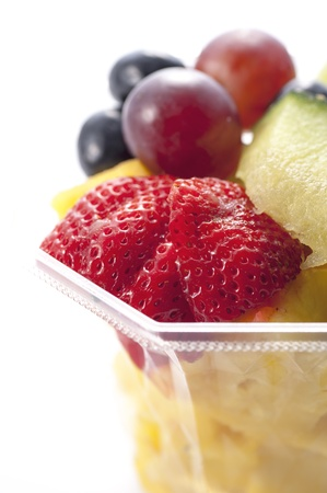 Fresh cut fruit into the plastic container  photo