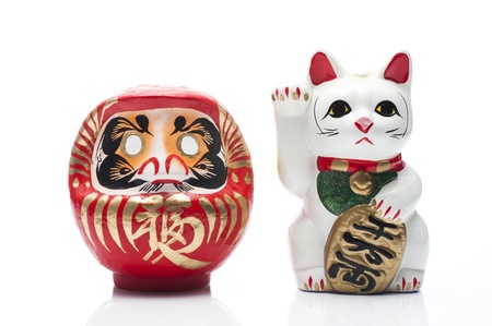 lucky cat and dharma on white background