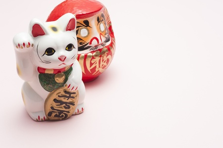 dharma: lucky cat and dharma on pink background