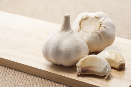 The garlic more than one on a cutting board Stok Fotoğraf