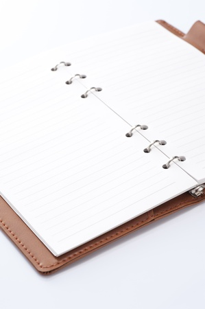 scheduler: opened notebook on white background, close-up