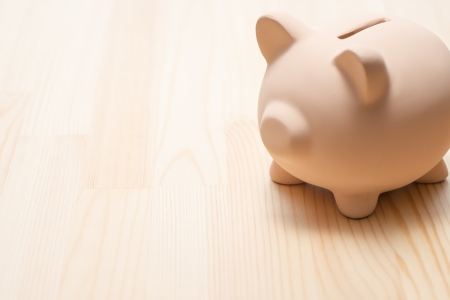 Piggy bank on wooden table 写真素材