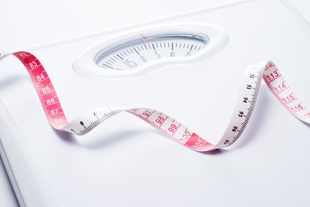Close-up of a tape measure and Bathroom scale 写真素材