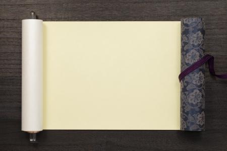 japanese scroll on dark wooden background