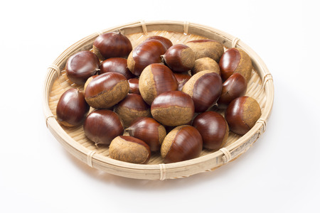 marron: chestnut into bamboo basket on white background