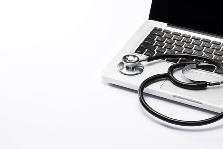 doctor computer: stethoscope on the keyboard of pc