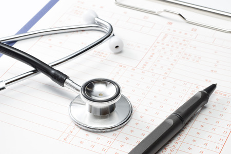 Medical record and Stethoscope, close up