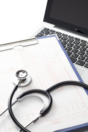 Laptop and stethoscope and medical records, medical concept photo