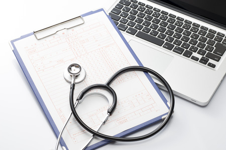 electronic survey: Laptop and stethoscope and medical records, medical concept