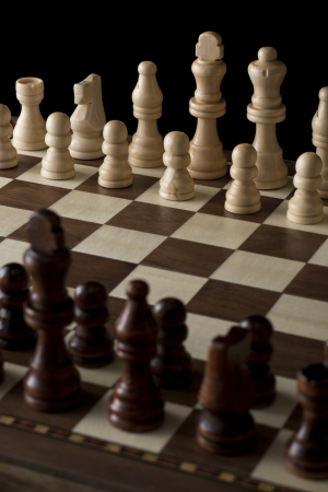 close-up shot of chess pieces on chessboard photo