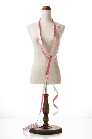 bespoke: mannequin with a tape measure on white background Stock Photo