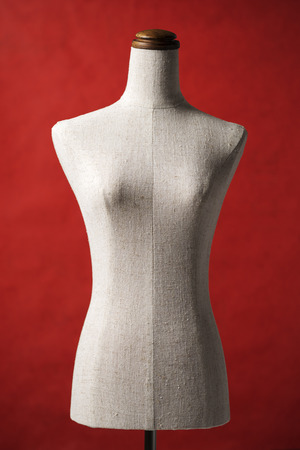 bespoke: A mannequin on red background