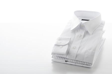 folded shirts on  white background 写真素材
