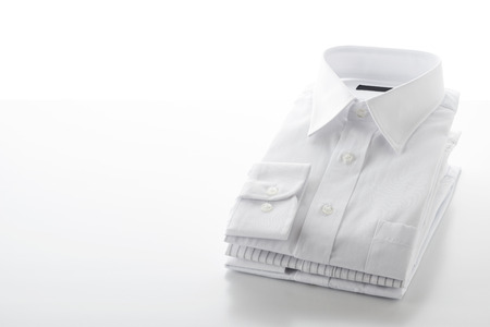 stack: folded shirts on  white background Stock Photo