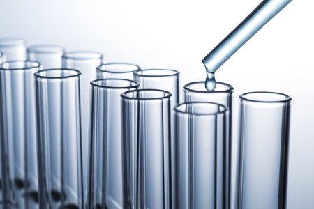 Liquid drop from pipette to laboratory glass test tube
