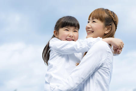 mother and daughter are both close 写真素材