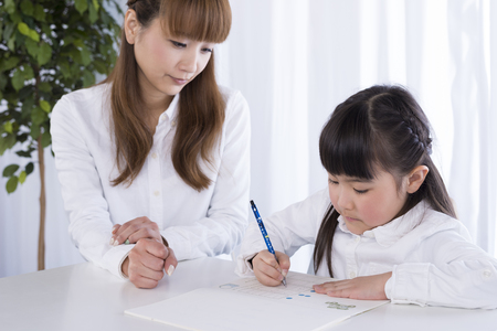 study: Parent and child to study Stock Photo