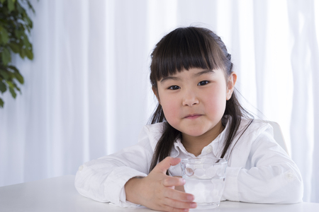 girl drinking water: Girl drinking water