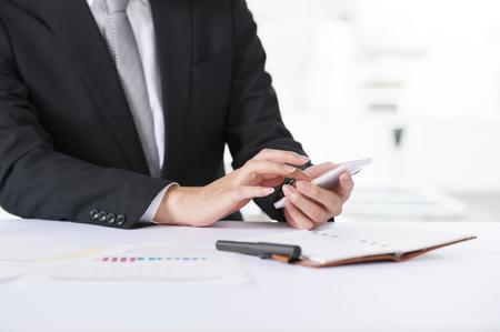 price hit: Businessman hitting the calculator