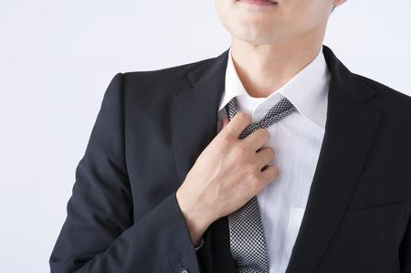 loosen: Man to loosen the tie