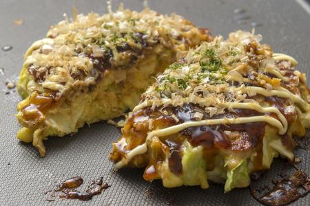 Okonomiyaki, a Japanese savoury pancake containing a variety ingredients Stok Fotoğraf