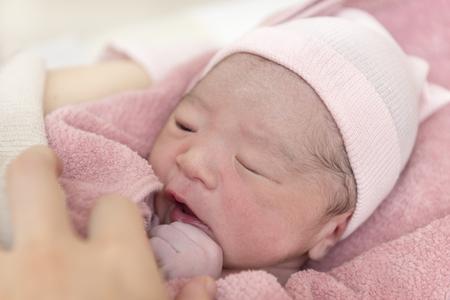 Born newborn baby by mother Stock Photo