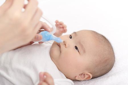 Suck off baby's runny nose