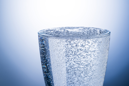 Transparent glass with carbonated water