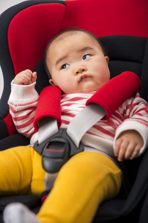 be strapped into a child safety seat