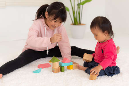 Sisters playing with blocks