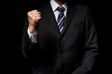 Presenting businessmen, black background